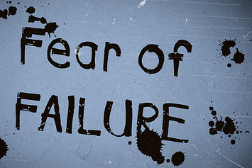 """""""Fear of Failure"""" written in thick lettering with ink blotches"""