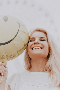 woman with balloon smiling, happy